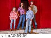 Купить «family of four standing on a saloon stage», фото № 20393391, снято 29 июня 2014 г. (c) Losevsky Pavel / Фотобанк Лори