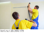 Купить «two male furniture assemblers in uniform drill walls with a vacuum cleaner», фото № 20394179, снято 9 июля 2014 г. (c) Losevsky Pavel / Фотобанк Лори