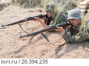 Купить «NELIDOVO, RUSSIA- JULY 12, 2014: Battlefield 2014: two Nazi soldiers with rifles in trench», фото № 20394235, снято 12 июля 2014 г. (c) Losevsky Pavel / Фотобанк Лори