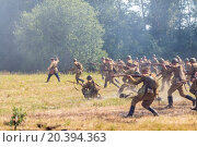 Купить «NELIDOVO, RUSSIA- JULY 12, 2014: Battlefield 2014: Red Army soldiers fired from rifles», фото № 20394363, снято 12 июля 2014 г. (c) Losevsky Pavel / Фотобанк Лори