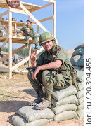 Купить «NELIDOVO, RUSSIA- JULY 12, 2014: Battlefield 2014: GI shows a gesture of peace sitting on bags», фото № 20394455, снято 12 июля 2014 г. (c) Losevsky Pavel / Фотобанк Лори