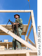 Купить «NELIDOVO, RUSSIA- JULY 12, 2014: Battlefield 2014: GI stands with the machine gun on observation tower», фото № 20394475, снято 12 июля 2014 г. (c) Losevsky Pavel / Фотобанк Лори