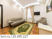 Купить «ADLER, RUSSIA - JULY 22, 2014: Interior of a hotel room with sofa, chair and carpet in Shine House hotel», фото № 20395227, снято 22 июля 2014 г. (c) Losevsky Pavel / Фотобанк Лори