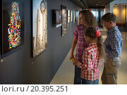 Купить «USA, NEW YORK - AUG 25, 2014: Woman and two children (models with releases) look photos and pictures in main office of Shutterstock.», фото № 20395251, снято 25 августа 2014 г. (c) Losevsky Pavel / Фотобанк Лори