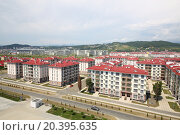 Купить «SOCHI, RUSSIA - JUL 25, 2014: The view from the Hotel Radisson Blu Paradise Resort and Spa to the street 65 years of Victory with new residential buildings», фото № 20395635, снято 25 июля 2014 г. (c) Losevsky Pavel / Фотобанк Лори