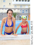 Купить «SOCHI, RUSSIA - JUL 28, 2014: Happy woman and girl (with model release) in swimsuits in the swimming pool of the Hotel Bogatyr», фото № 20396111, снято 28 июля 2014 г. (c) Losevsky Pavel / Фотобанк Лори