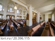 Купить «MOSCOW - JUNE 9, 2014: pews, altar and stained glass windowson the mraornom floor of Cathedral of St. Peter and Paul», фото № 20396115, снято 9 июня 2014 г. (c) Losevsky Pavel / Фотобанк Лори