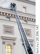Купить «MOSCOW - December 8, 2014: Firefighters at the fire stairs rise to the burning window of State Academic Bolshoi Theatre of Russia Historical scene», фото № 20396147, снято 8 декабря 2014 г. (c) Losevsky Pavel / Фотобанк Лори