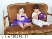 Купить «Beautiful little children in white and purple costumes sitting on couch», фото № 20396491, снято 1 апреля 2014 г. (c) Losevsky Pavel / Фотобанк Лори