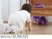 Купить «Little boy sitting on floor and looks at girl in purple skirt behind sofa», фото № 20396523, снято 1 апреля 2014 г. (c) Losevsky Pavel / Фотобанк Лори