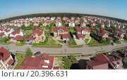 Купить «Aerial view car rides by road in cottage town at sunny summer day.», фото № 20396631, снято 5 июня 2014 г. (c) Losevsky Pavel / Фотобанк Лори