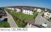 Купить «Cottage settlement near forest at sunny summer day. Aerial view», фото № 20396923, снято 5 июня 2014 г. (c) Losevsky Pavel / Фотобанк Лори
