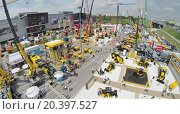 Купить «RUSSIA, MOSCOW - JUN 6, 2014: People walk by International Specialized Exhibition of Construction Equipment and Technologies CET 2014 at international exhibition center Crocus Expo. Aerial view. Photo with noise from action camera», фото № 20397527, снято 6 июня 2014 г. (c) Losevsky Pavel / Фотобанк Лори