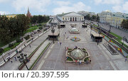 Купить «MOSCOW - AUG 12, 2014: Fountains on Manezh Square, aerial view. View of the Central Exhibition Hall», фото № 20397595, снято 12 августа 2014 г. (c) Losevsky Pavel / Фотобанк Лори