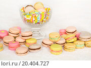 Купить «Colorful cookies with cream on table and in glass vase», фото № 20404727, снято 2 апреля 2014 г. (c) Losevsky Pavel / Фотобанк Лори