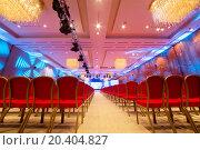 Купить «Meeting room with red chairs and colored illumination», фото № 20404827, снято 11 декабря 2013 г. (c) Losevsky Pavel / Фотобанк Лори