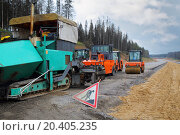 Купить «MOSCOW - SEP 20: Special road machinery in the construction of a new highway between Moscow and Saint Petersburg, on September 20, 2013 in Moscow, Russia.», фото № 20405235, снято 20 сентября 2013 г. (c) Losevsky Pavel / Фотобанк Лори