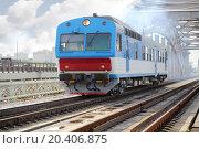 Купить «Small blue train rides rails on railway bridge at summer day.», фото № 20406875, снято 19 июля 2013 г. (c) Losevsky Pavel / Фотобанк Лори