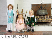 Купить «Two boys and girl in medieval costumes are near fireplace with boiler and logs.», фото № 20407375, снято 2 ноября 2013 г. (c) Losevsky Pavel / Фотобанк Лори