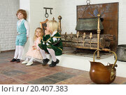 Купить «Two boys and girl in medieval costumes sit near fireplace with logs and hanging pot.», фото № 20407383, снято 2 ноября 2013 г. (c) Losevsky Pavel / Фотобанк Лори