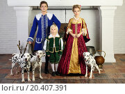 Купить «Father, mother and son in medieval costumes stand near fireplace with three dalmatians.», фото № 20407391, снято 2 ноября 2013 г. (c) Losevsky Pavel / Фотобанк Лори