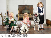 Купить «Two happy boys and little girl in medieval costumes with three dalmatians sit near fireplace.», фото № 20407499, снято 2 ноября 2013 г. (c) Losevsky Pavel / Фотобанк Лори