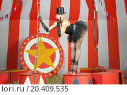 Купить «Actress in black tutu and top hat holding finger to mouth and stands on pedestal», фото № 20409535, снято 19 апреля 2014 г. (c) Losevsky Pavel / Фотобанк Лори