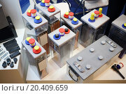 Купить «Some rechargeable battery with different sizes stand on table», фото № 20409659, снято 4 декабря 2013 г. (c) Losevsky Pavel / Фотобанк Лори