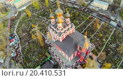 Купить «Orthodox church of the Tikhvin Icon of Our Lady with four domes on territory of cemetery, view from unmanned quadrocopter.», фото № 20410531, снято 19 октября 2013 г. (c) Losevsky Pavel / Фотобанк Лори