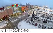 Купить «SAMARA, RUSSIA - JAN 05, 2014 : Aerial view to territory of store Mega in Samara with car parking in evening.», фото № 20410603, снято 5 января 2014 г. (c) Losevsky Pavel / Фотобанк Лори