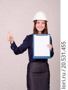 Купить «Girl in helmet standing with a folder hand», фото № 20531455, снято 12 февраля 2020 г. (c) easy Fotostock / Фотобанк Лори