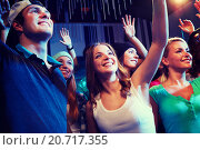 Купить «smiling friends at concert in club», фото № 20717355, снято 20 октября 2014 г. (c) Syda Productions / Фотобанк Лори