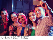 Купить «friends with glasses and smartphone in club», фото № 20717527, снято 20 октября 2014 г. (c) Syda Productions / Фотобанк Лори