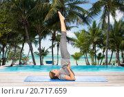 Купить «woman making yoga in shoulderstand pose on mat», фото № 20717659, снято 13 ноября 2015 г. (c) Syda Productions / Фотобанк Лори