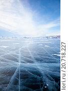 Купить «Winter ice landscape on lake Baikal with dramatic weather clouds front before the Storm», фото № 20718227, снято 16 марта 2013 г. (c) Serg Zastavkin / Фотобанк Лори