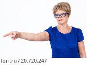 Купить «Строгая рассерженная женщина указывает указательным пальцем в сторону, белый фон», фото № 20720247, снято 13 декабря 2015 г. (c) Кекяляйнен Андрей / Фотобанк Лори