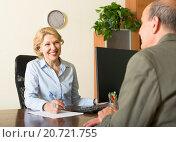 Купить «Public notary with senior client», фото № 20721755, снято 17 июня 2014 г. (c) Яков Филимонов / Фотобанк Лори