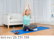 Купить «woman making yoga meditation in lotus pose on mat», фото № 20731159, снято 27 ноября 2015 г. (c) Syda Productions / Фотобанк Лори