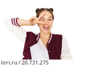 Купить «happy smiling teenage girl showing peace sign», фото № 20731275, снято 19 декабря 2015 г. (c) Syda Productions / Фотобанк Лори