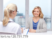 Купить «smiling doctor and woman meeting at hospital», фото № 20731779, снято 14 декабря 2018 г. (c) Syda Productions / Фотобанк Лори
