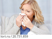 Купить «ill woman blowing nose to paper napkin», фото № 20731859, снято 27 ноября 2015 г. (c) Syda Productions / Фотобанк Лори