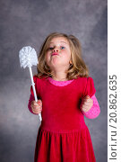 Купить «funny girl playing with toilet brush», фото № 20862635, снято 17 июля 2018 г. (c) PantherMedia / Фотобанк Лори