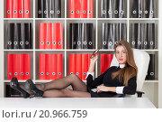 Купить «Женщина-руководитель сидит в офисе, закинув ноги на стол», фото № 20966759, снято 16 января 2016 г. (c) Литвяк Игорь / Фотобанк Лори