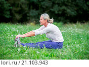Купить «Woman stretching.», фото № 21103943, снято 27 августа 2015 г. (c) age Fotostock / Фотобанк Лори