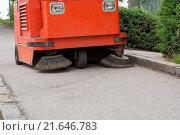 Купить «Cleaning off the sidewalk with cleaning machine», фото № 21646783, снято 25 июня 2019 г. (c) easy Fotostock / Фотобанк Лори