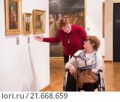 Купить «Two woman whatching art works», фото № 21668659, снято 21 марта 2019 г. (c) Яков Филимонов / Фотобанк Лори