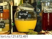 Купить «Напитки в кувшинах на прилавке кафе», эксклюзивное фото № 21672491, снято 21 августа 2015 г. (c) lana1501 / Фотобанк Лори