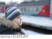 Купить «Teen boy on platform of train background», фото № 21675207, снято 30 ноября 2013 г. (c) Володина Ольга / Фотобанк Лори
