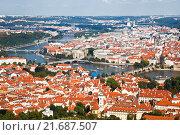 Купить «Top view of Prague, red roofs of the houses, the bridges over Vltava, Czech Republic», фото № 21687507, снято 7 сентября 2014 г. (c) Наталья Волкова / Фотобанк Лори