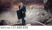Купить «Composite image of smiling businessman in a hurry», фото № 21689835, снято 17 декабря 2018 г. (c) Wavebreak Media / Фотобанк Лори